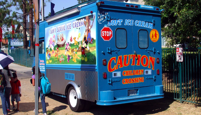 An ice cream truck parked around the corner from Joli Ann Leichtag Elementary School