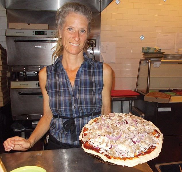 """""""It's the 'New Zealand,'"""" says Sarah of the pizza she's just made. It's 14 inches, piled high with cheeses, chunks of meat, red onions."""