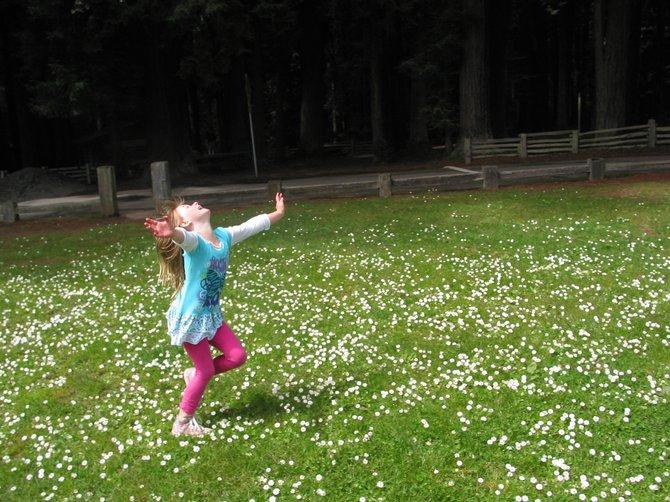 My granddaughter dancing in a Redwood park in Eureka, CA