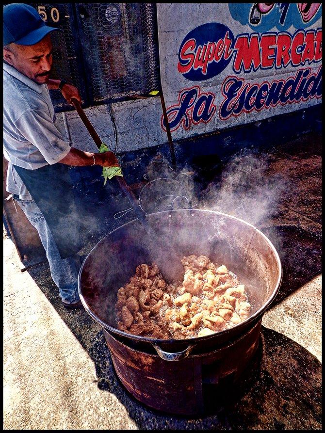 Neighborhood Photos TIJUANA,BAJA CALIFORNIA Deep Fried Pork better known as Carnitas being cook in Buenavista Section of Tijuana by master cook Jose Ramos /Carnitas siendo cocinadas en Colonia Buenavista de Tijuana por el maestro cocinero Jose Ramos.