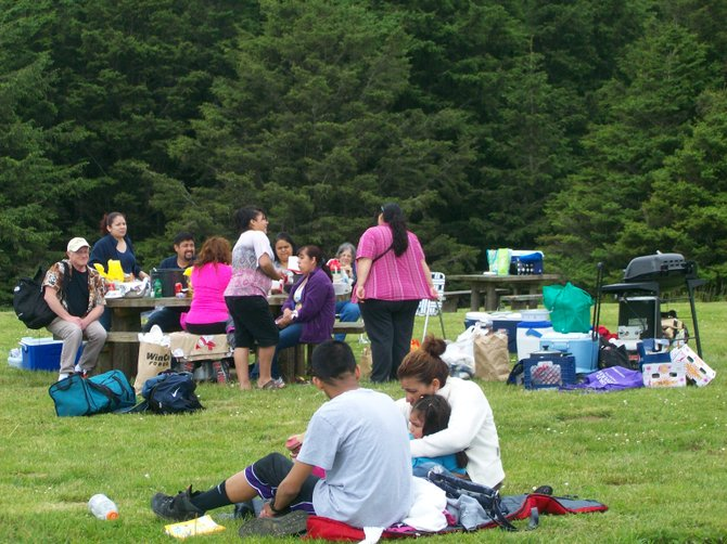 Families enjoy a rare non-rainy day at Ecola State Park near Seaside, Oregon.
