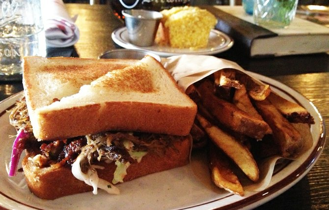The braised beef short rib sandwich on Texas toast with beer-brined French fries
