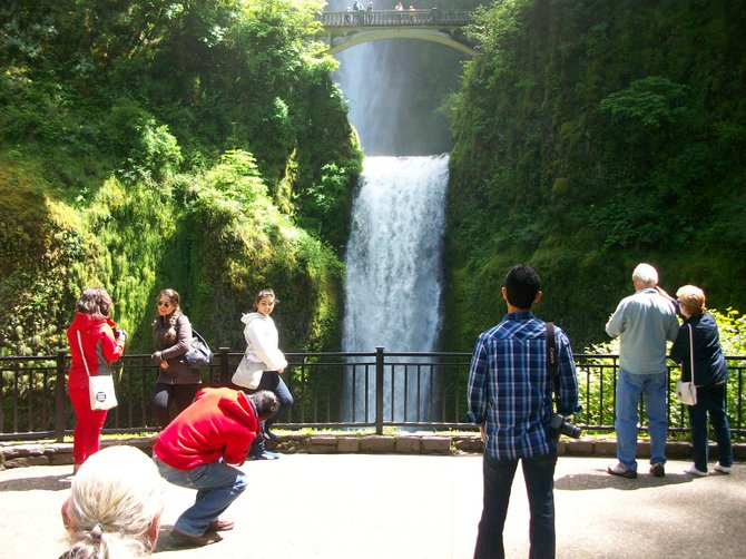 People gather to gawk at Moltnomah Falls in Oregon's Columbia River Gorge.