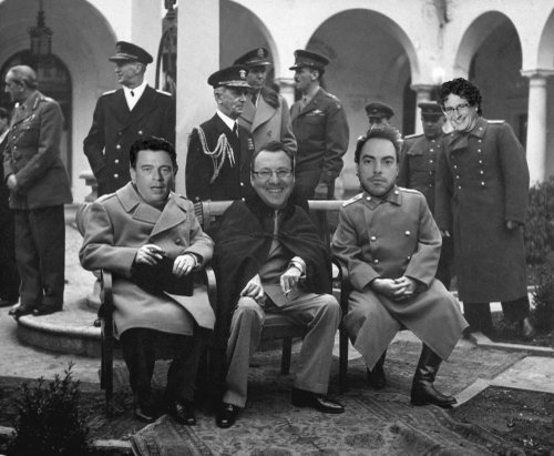 Prime Minister Marks, President Wright, Premier Heath, and Grand High Exalted Mystic Ruler Lickona yuk it up during a spirited round of musical chairs at last year's Yalta Film Festival.