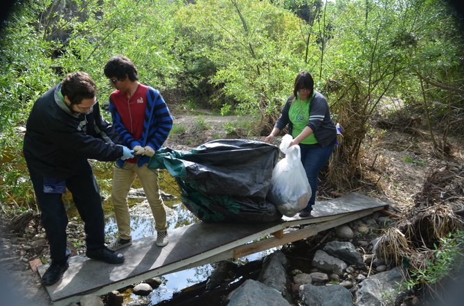 Mesa College geology class students help clean up Tecolote Canyon during Canyon Days event.