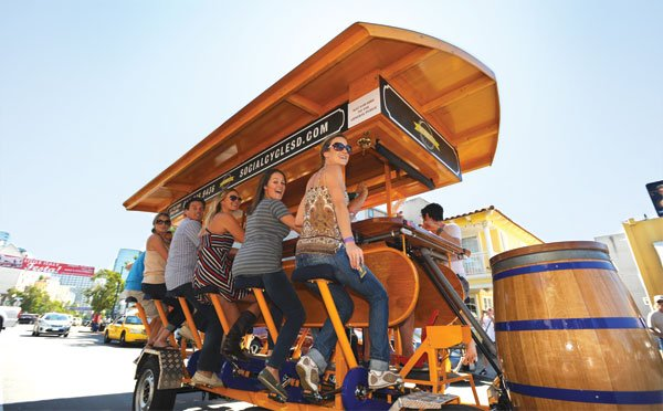Six passengers are required to pedal the Social Cycle, but each bike bus can carry  up to 16 people.