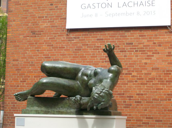 """I've Fallen & I Can't Get Up"" statue at Portland Art Museum."