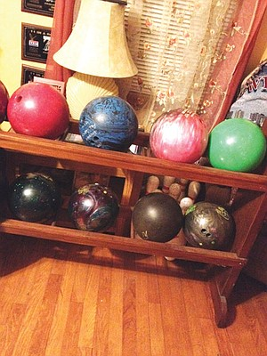 Yes, my dad has a bowling-ball rack. In his living room.