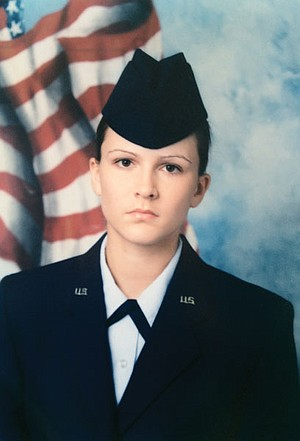 Even after weeks of being yelled at and herded like cattle, I managed to maintain impressively over-plucked eyebrows for my Air Force portrait.