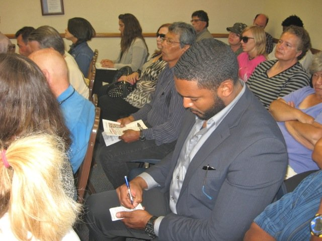 Kamaal Martin takes notes for state-assembly member Shirley Weber's office