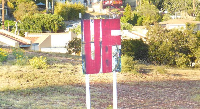 """The """"For Sale"""" sign was covered in graffiti shortly after it went up in the spring of 2012, and no one has bothered to put up a new one. - Image by Irvin Gavidor"""