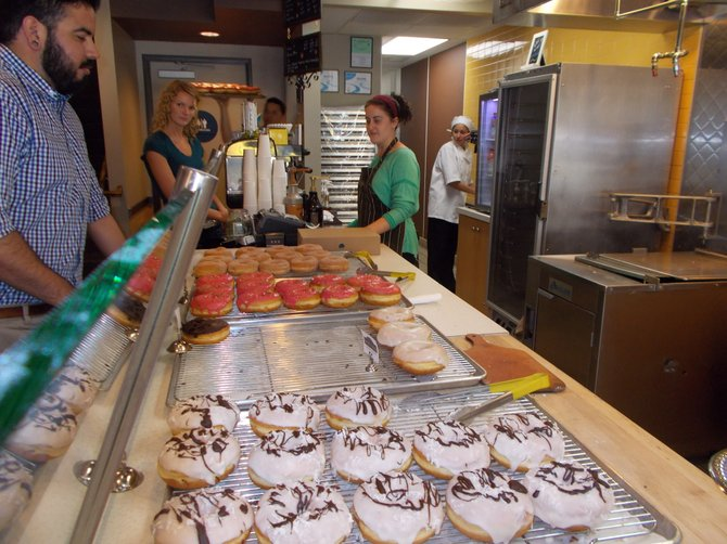 Coconut Dreams and Raspberry Pistachio donuts await their fate