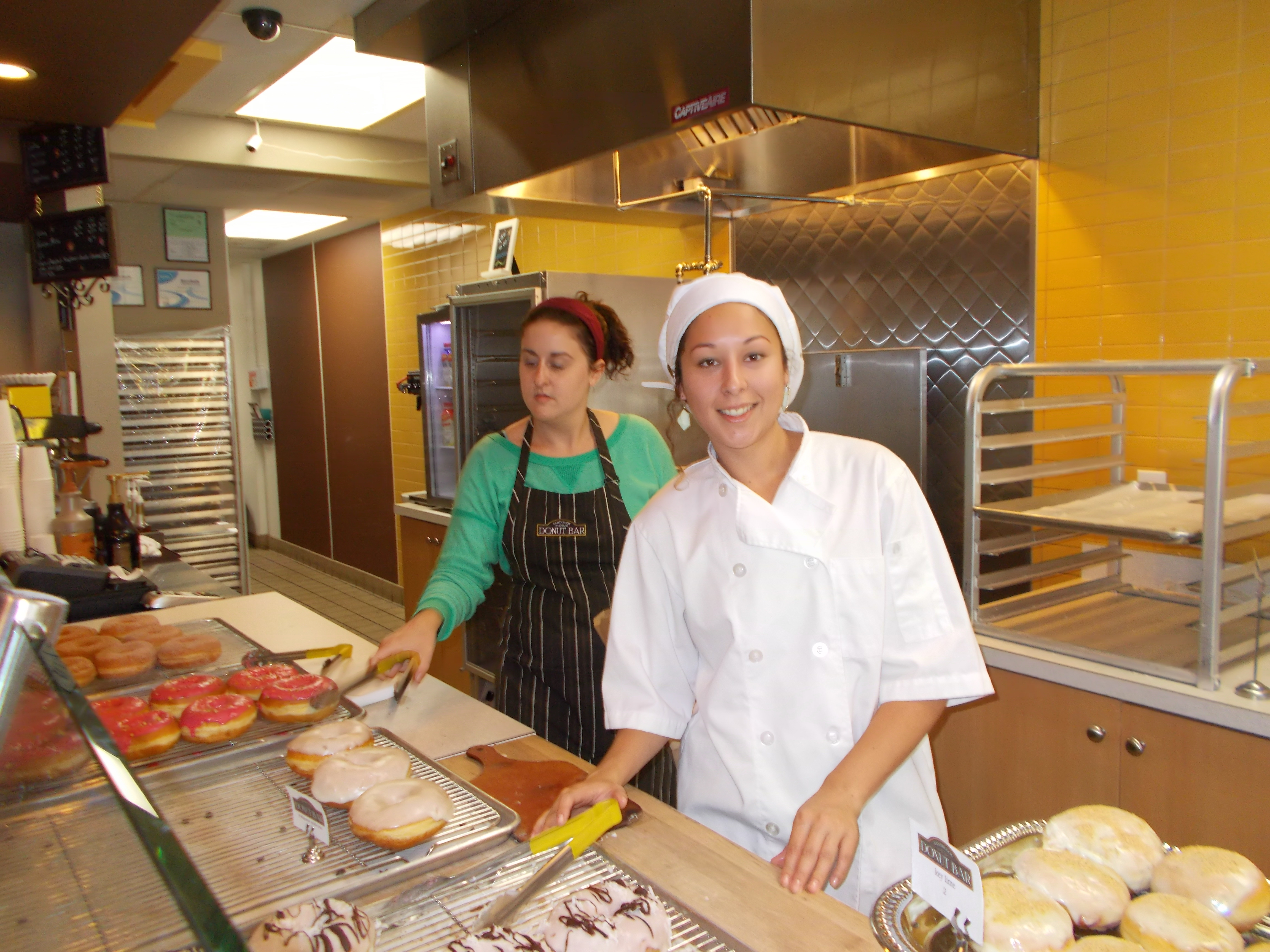 Server Emily and cook Sarai keep the donuts moving