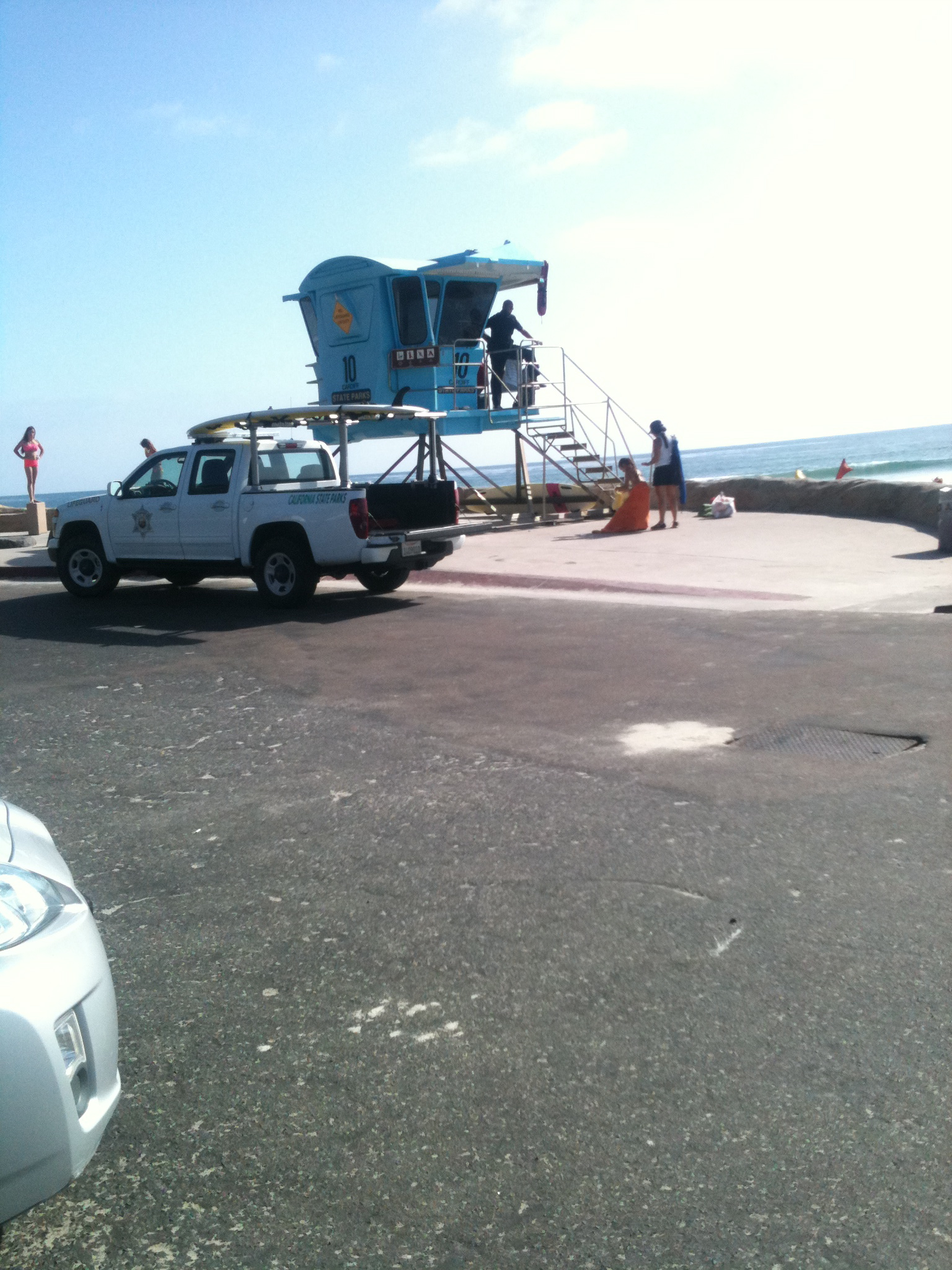 This armed lifeguard illegally parked in a red zone after threatening beachgoers with tickets for the same offense.