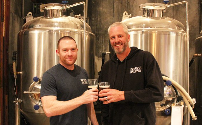 Thorn St. Brewery partners Dennis O'Connor (left) and Dan Carrico pose in their soon-to-be-expanded brewery.