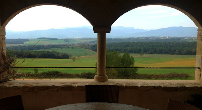 The Pyrenees and hills of la Garrotxa above the chapel terrace in San Bartomeo de Torres, near Girona.