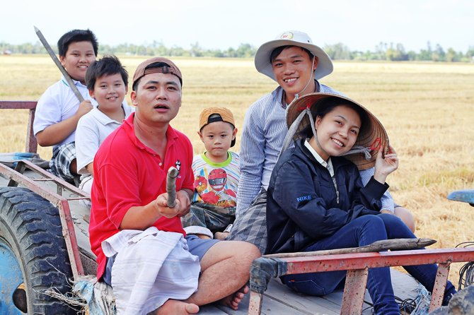 I traveled in Kien Giang Viet Nam. I took my Vietnamese friends. They were going harvest their crops with smiley face.