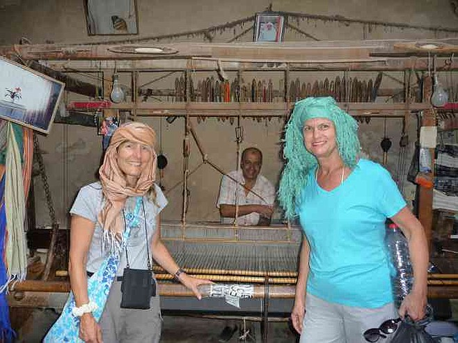 Trying on headwraps in the scarf-making shop.