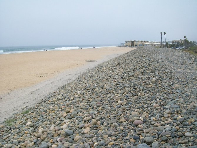 The cobblestone barrier between the beach and the Tijuana Estuary where a student paraglider was dragged to his death.