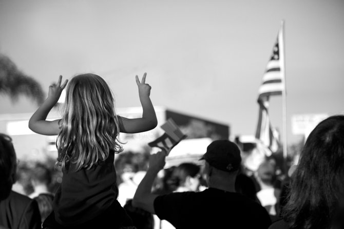 A little girl flashes peace signs during the rally in Hillcrest on June 26th, 2013.
