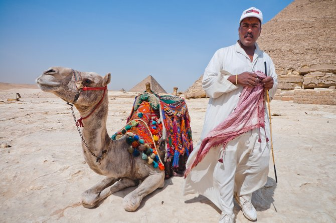 Friends forever: Egyptian guide and his camel in front of Khafre's Pyramid.
