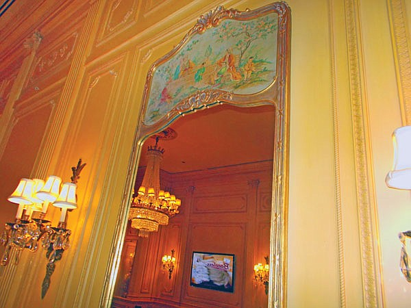 Eighteenth-century French tapestries and gilded-frame mirrors hang on the walls.