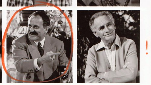 """The Zorba: """"JOE PESCI (left) points in envy at his coiffure superior JOEY 'SON-OF-A-GUN' BISHOP in 'BETSY'S WEDDING,' yet another failed attempt by Alan Alda to separate himself from the character he played on 'M*A*S*H*. Buena Vista Pictures distributes."""""""