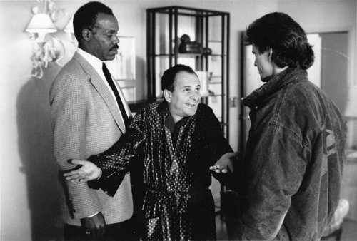 "The Skin Diver Shock or the 'Wanna' check for foreskin, Mel?' cut: ""L.A. police detectives Roger Murtaugh (DANNY GLOVER, left) and Martin Rigg's (MEL GIBSON, right) latest official duty is to provide protective custody to Leo Getz (JOE PESCI), an accountant who has laundered nearly half a billion dollars in narcotics money, in Warner Bros.' new action-thriller 'Lethal Weapon 2.'"""