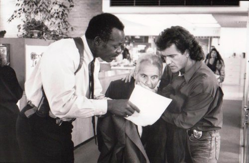 "Dying for Sequel Money: ""Detectives Martin Riggs (MEL GIBSON) and Roger Murtaugh (DANNY GLOVER) stifle a shocked reaction from Leo Getz (JOE PESCI) in Warner Bros.' action-adventure, 'Lethal Weapon 3,' also starring Rene Russo."""