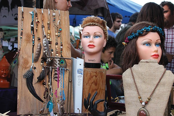 Hemp, feathers, and beads on disembodied mannequin heads