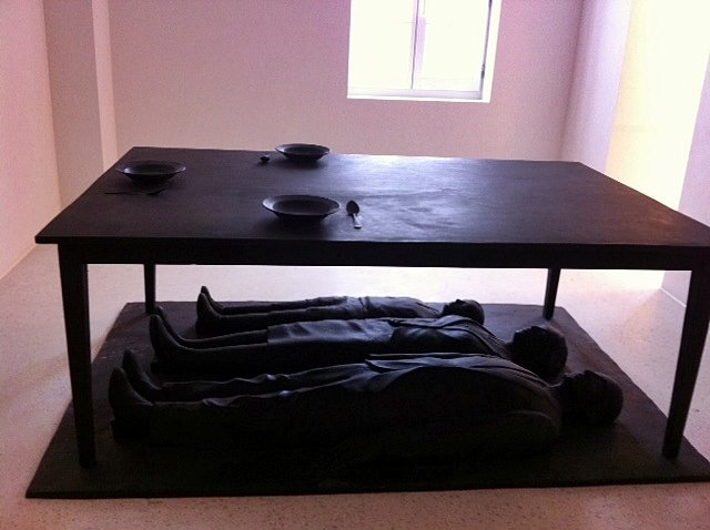 """Holocaust memorial in lobby of """"luxury apartments"""" – formerly Dossin Barracks."""