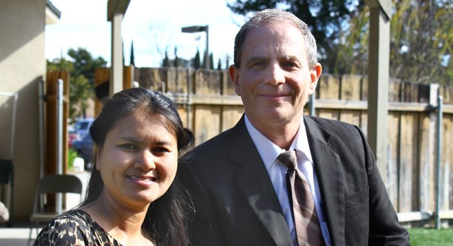 """Pastor Victor Vaughn, with his wife Natasha, says """"It's not my job to point my finger and condemn people to hell."""""""