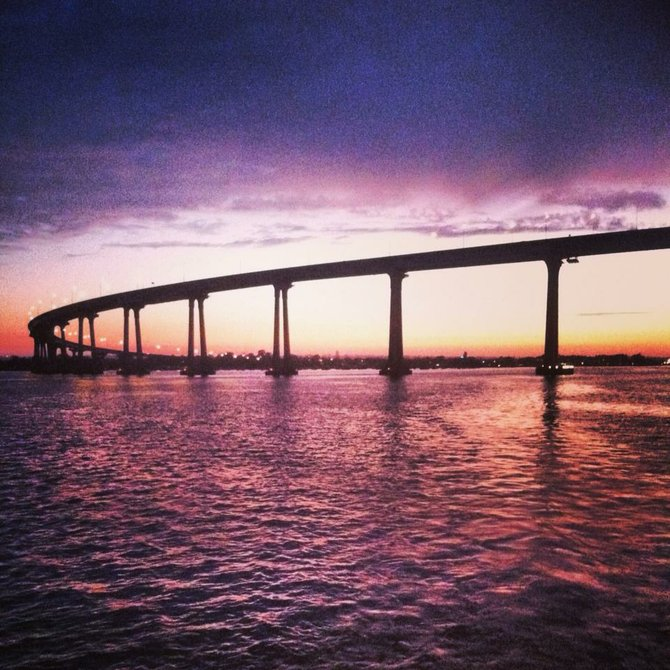 Coronado Bridge with a beautiful pink sunset - via Flagship Harbor Cruises dinner cruise. It was the most simple, fun night I've had in a while!