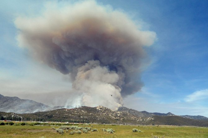 Smoke and flames rise from what is being called the Mountain fire, in the San Jacinto Mountains near the town of Hemet. The fire is currently threatening the town of Idyllwild,.