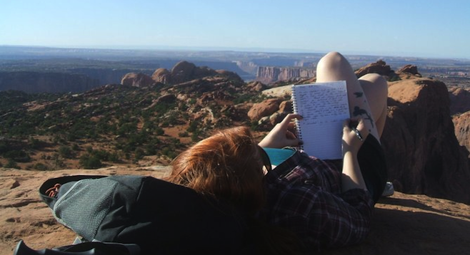 Enjoying a crowd-free overlook near Canyonland's Upheaval Dome.