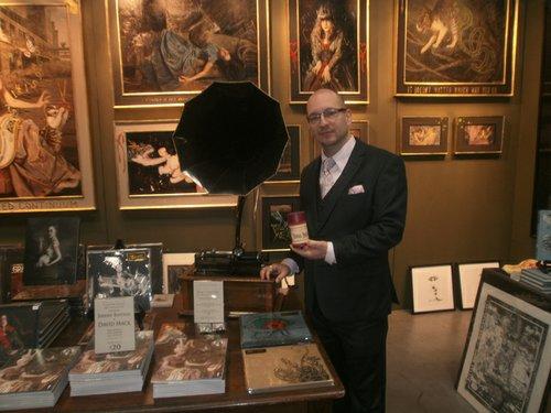 Thomas Negovan displays one of his wax cylinders. Photo by Bart Mendoza