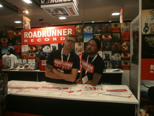 The crew at the Road Runner Records Booth. Photo by Bart Mendoza.