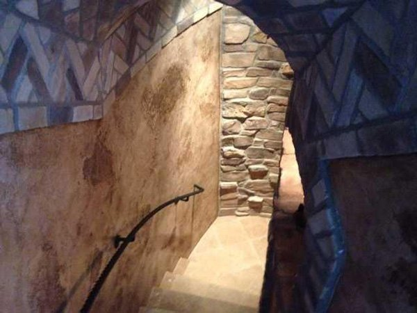 This hall of stone-and-brick inlaid walls leads to a stone wine cellar.