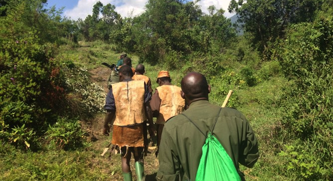On the trail with the Batwa guides.