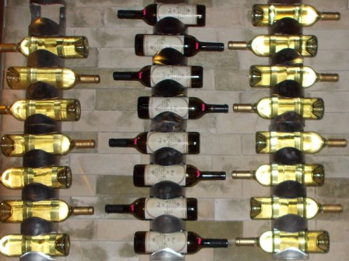 Wine bottles stored up counter wall