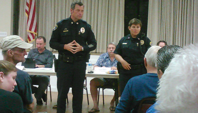 San Diego police Cpt. Andy Mills and Lt. Natalie Stone listen to the audience
