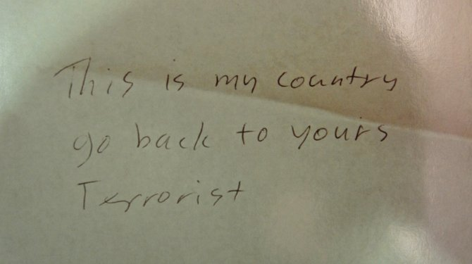 Photocopied note found near bloody woman w hateful message. Evidence photo