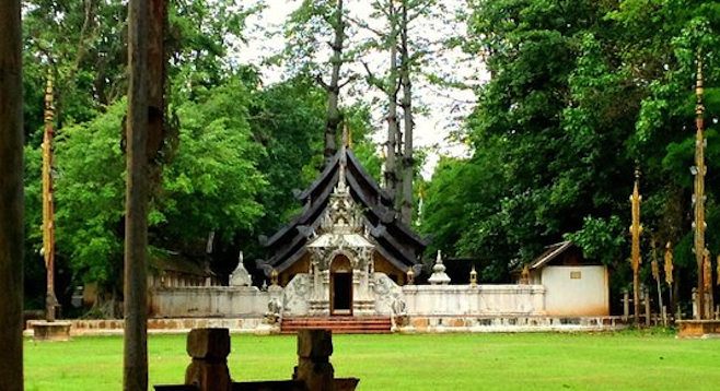 Buddhist shrine in lush forest, Chiang Mai.