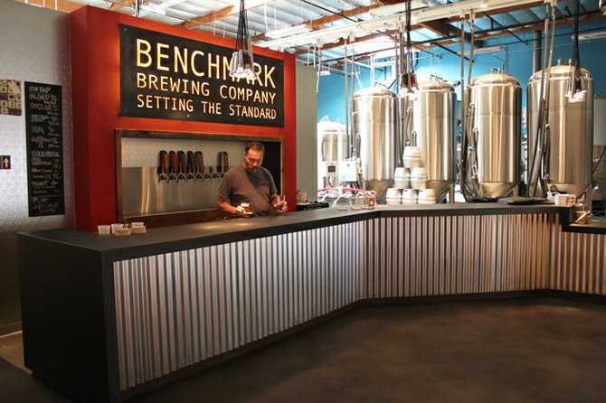Jim Akin tends to business at Benchmark's tasting bar
