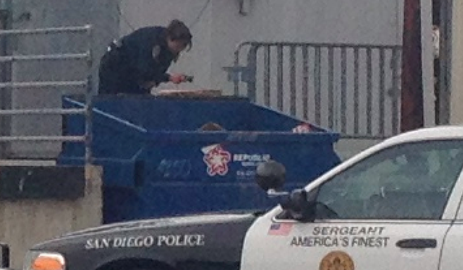 At least three police cars showed up to investigate the alleged burning of district documents.