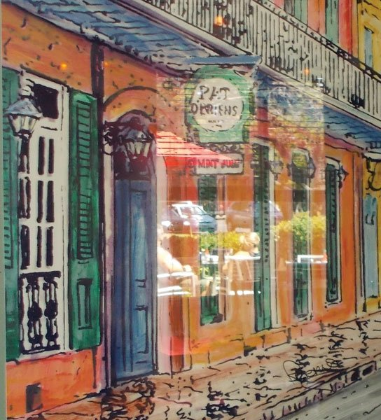 Paintings of New Orleans hang on the walls at Bud's.