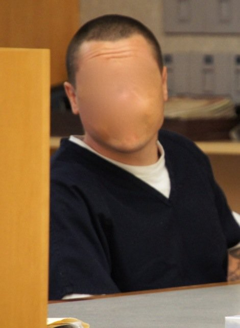 Judge ordered face obscured.