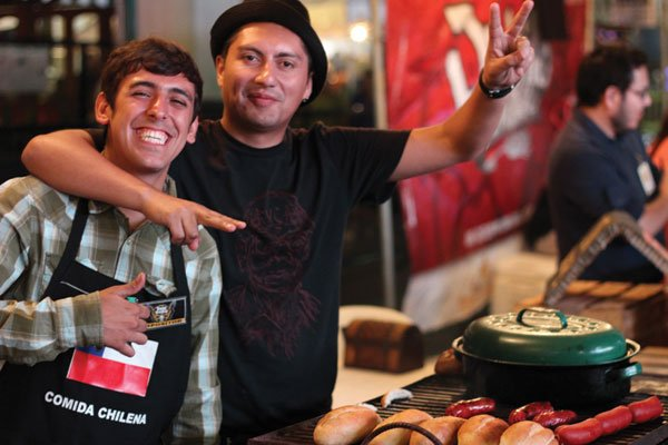 Chilean-style sausage vendors dish out the cheese.