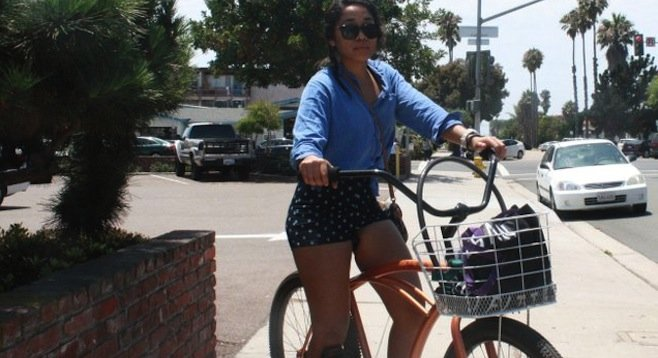 Yesenia Meadows on her Isla Vista cruiser