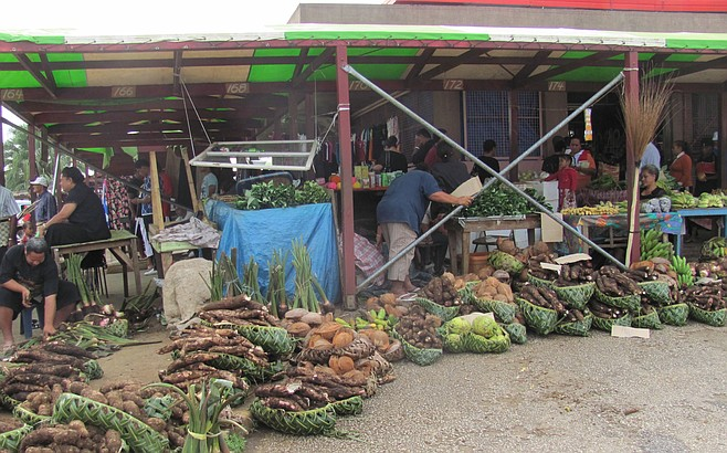 Vendors display local produce at a Tonga market.